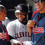 Cleveland Indians first baseman Carlos Santana, center, celebrates a home run against the Minnesota Twins during their baseball game in Minneapolis, Sunday, Sept. 9, 2012. (AP Photo/Craig La …