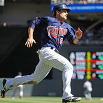 Minnesota Twins second baseman Jamey Carroll rounds third base against Cleveland Indians during their baseball game in Minneapolis, Sunday, Sept. 9, 2012. (AP Photo/Craig Lassig)