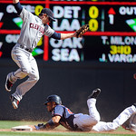 Minnesota Twins' Ben Revere, right, steals second as Cleveland Indians shortstop Brent Lillibridge, left, jumps to catch the throw in the fourth inning of their baseball game in Minneapolis, …