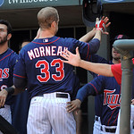 Minnesota Twins first baseman Justin Morneau, right, celebrates a home run against Cleveland Indians in the third inning of their baseball game in Minneapolis, Sunday, Sept. 9, 2012. Twins w …