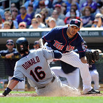 Cleveland Indians' Jason Donald, left, scores on a wild pitch by Minnesota Twins pitcher Esmerling Vasquez, right, as Vasquezis is too late with the tag in the second inning of their basebal …