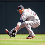 Cleveland Indians second baseman Jason Kipnis grabs a ground ball against the Minnesota Twins during their baseball game in Minneapolis, Sunday, Sept. 9, 2012. (AP Photo/Craig Lassig)