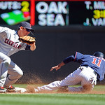 Minnesota Twins center fielder Ben Revere, right, steals second as  Cleveland Indians  shortstop Brent Lillibridge, left, attempts a tag in the seventh inning of their baseball game in Minne …