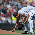 Cleveland Indians pitcher Esmil Rogers takes a close look at the mound during their game against the Minnesota Twins in Minneapolis, Sunday, Sept. 9, 2012. (AP Photo/Craig Lassig)