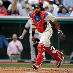 Cleveland Indians catcher Carlos Santana chases down an errant ball during a baseball game against the New York Yankees Monday, April 8, 2013, in Cleveland. (AP Photo/Mark Duncan)