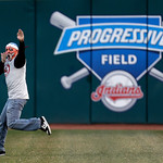 A Cleveland Indians fan runs out on the field in the ninth inning of a home opener baseball game against the New York Yankees, Monday, April 8, 2013, in Cleveland. New York won 11-6. (AP Pho …