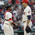 Cleveland Indians starting pitcher Ubaldo Jimenez, right, talks with catcher Carlos Santana in the fifth inning of a home opener baseball game, Monday, April 8, 2013, in Cleveland. (AP Photo …