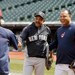 New York Yankees bench coach Tony Pena, center, greets Cleveland Indians catcher Carlos Santana, left, and former Indians second baseman Carlos Baerga before a baseball game Monday, April 8, …