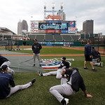 New York Yankees manager Joe Girardi watches teammates stretch before the Yankees play the Cleveland Indians in a home opener baseball game, Monday, April 8, 2013, in Cleveland. (AP Photo/To …
