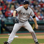 New York Yankees relief pitcher Boone Logan pitches in the seventh inning of a home opener baseball game against the Cleveland Indians, Monday, April 8, 2013, in Cleveland. (AP Photo/Tony De …