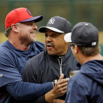 Cleveland Indians' Jason Giambi, left, wrestles with New York Yankees bench coach Tony Pena before a baseball game Monday, April 8, 2013, in Cleveland. (AP Photo/Mark Duncan)