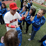 Cleveland Indians' Nick Swisher runs through a gauntlet of fans before a baseball game against the New York Yankees Monday, April 8, 2013, in Cleveland. (AP Photo/Mark Duncan)