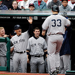 New York Yankees manager Joe Girardi greets Travis Hafner (33) after Hafner hit a three-run home run in the first inning of a home opener baseball game against the Cleveland Indians, Monday, …