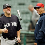 New York Yankees third baseman Kevin Youkilis, left, talks with Cleveland Indians manager Terry Francona before a baseball game Monday, April 8, 2013, in Cleveland. (AP Photo/Mark Duncan)