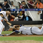 American League's Prince Fielder, of the Detroit Tigers, dives into third base for a triple  ahead of the throw to National League's Pedro Alvarez, of the Pittsburgh Pirates, in the nint …