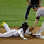 National League's Andrew McCutchen, of the Pittsburgh Pirates, safely steals second under the tag of American League's J.J. Hardy, of the Baltimore Orioles, during the MLB All-Star baseb …