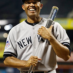 American League's Mariano Rivera, of the New York Yankees,  poses with the MVP trophy after the MLB All-Star baseball game, on Tuesday, July 16, 2013, in New York. The American League defe …