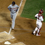 American League's Miguel Cabrera, of the Detroit Tigers, scores in front of National League's Yadier Molina, of the St. Louis Cardinals, during the fourth inning of the MLB All-Star base …