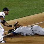 American League's Prince Fielder, of the Detroit Tigers, slides safely under the tag of National League's Pedro Alvarez, of the Pittsburgh Pirates, for a triple during the ninth inning o …