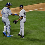 American League's Mariano Rivera, of the New York Yankees, talks to American League's catcher Salvador Perez, of the Kansas City Royals, after pitching during the eighth inning of the ML …