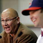 Cleveland Indians manager Terry Francona, left, answers questions as Nick Swisher smiles during a baseball news conference, Thursday, Jan. 3, 2013, in Cleveland. Swisher passed his physical  …