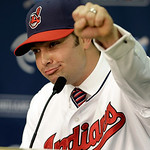 Cleveland Indians' Nick Swisher pumps his fist during a baseball news conference, Thursday, Jan. 3, 2013, in Cleveland. Swisher passed his physical with the Indians on Thursday and signed th …