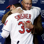Cleveland Indians' Nick Swisher hugs manager Terry Francona, rear, during a baseball news conference, Thursday, Jan. 3, 2013, in Cleveland. Swisher passed his physical with the Indians on Th …