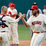 Cleveland Indians relief pitcher Chris Perez, right, and catcher Luke Carlin celebrate their 8-5 win over the Kansas City Royals in a baseball game, Monday, May 28, 2012, in Cleveland. (AP P …
