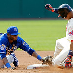 Kansas City Royals second baseman Irving Falu, left, tags out Cleveland Indians' Jose Lopez trying for a double in the fifth inning of a baseball game, Monday, May 28, 2012, in Cleveland. In …