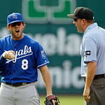 Kansas City Royals third baseman Mike Moustakas argues with second base umpire Dan Bellino in the third inning of a baseball game against the Cleveland Indians, Monday, May 28, 2012, in Clev …