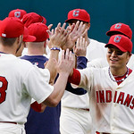 Cleveland Indians right fielder Shin-Soo Choo, right, from South Korea, celebrates with his teammates after their 8-5 win over the Kansas City Royals in a baseball game, Monday, May 28, 2012 …