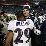 Baltimore Ravens cornerback Cary Williams (29) talks with New England Patriots quarterback Tom Brady, rear, after the NFL football AFC Championship football game in Foxborough, Mass., Sunday …