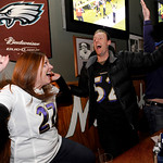Baltimore Ravens fans Megan Royer, left, and Kit Taylor react while watching a televised broadcast of the AFC Championship NFL football game between the Ravens and the New England Patriots, …
