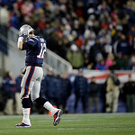 New England Patriots quarterback Tom Brady walks off the field during the second half of the NFL football AFC Championship football game against the Baltimore Ravens in Foxborough, Mass., Su …