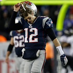 New England Patriots quarterback Tom Brady takes off his helmet following an interception during the second half of the NFL football AFC Championship football game against the Baltimore Rave &#8230;