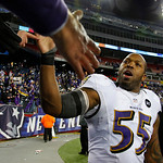 Baltimore Ravens outside linebacker Terrell Suggs shakes hands with spectators following the NFL football AFC Championship football game against the New England Patriots in Foxborough, Mass. …