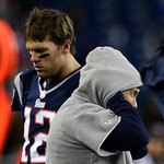 New England Patriots quarterback Tom Brady (12) walks past Patriots head coach Bill Belichick after throwing an interception during the second half of the NFL football AFC Championship footb &#8230;