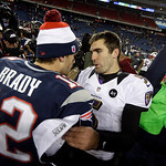 New England Patriots quarterback Tom Brady (12) meets with Baltimore Ravens quarterback Joe Flacco (5) after the NFL football AFC Championship football game in Foxborough, Mass., Sunday, Jan …