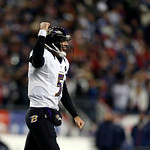 Baltimore Ravens quarterback Joe Flacco (5) reacts after throwing an 11-yard touchdown pass to Anquan Boldin during the second half of the NFL football AFC Championship football game against …
