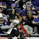 Baltimore Ravens running back Ray Rice, center, is surrounded by fans in the stands as he celebrates winning the NFL football AFC Championship football game against the New England Patriots  …