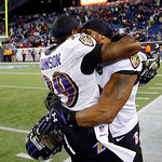 Baltimore Ravens defensive back Chris Johnson (39) hugs Baltimore Ravens inside linebacker Ray Lewis, right, after the NFL football AFC Championship football game against the New England Pat …