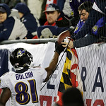 Baltimore Ravens wide receiver Anquan Boldin hands the football to a fan after scoring on an 11-yard touchdown pass during the second half of the NFL football AFC Championship football game …