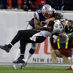 Baltimore Ravens tight end Dennis Pitta (88) is tackled by New England Patriots outside linebacker Jerod Mayo (51) during the second half of the NFL football AFC Championship football game i …