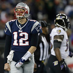 New England Patriots quarterback Tom Brady looks up at the scoreboard during the second half of the NFL football AFC Championship football game against the Baltimore Ravens in Foxborough, Ma …