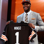 Defensive end Barkevious Ming from Louisiana State holds up the team jersey after being selected sixth overall by the Cleveland Browns in the first round of the NFL football draft, Thursday, …