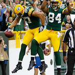 Green Bay Packers' Jordy Nelson (87) celebrates with  D.J. Williams (84) after catching a touchdown pass during the first half of a preseason NFL football game against the Cleveland Browns T …