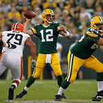Green Bay Packers' Aaron Rodgers drops back to pass during the first half of a preseason NFL football game against the Cleveland Browns Thursday, Aug. 16, 2012, in Green Bay, Wis. (AP Photo/ …