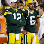 Green Bay Packers quarterback Aaron Rodgers (12) stands with quarterback Graham Harrell (6) on the sidelines during the second half of a preseason NFL football game against the Cleveland Bro …