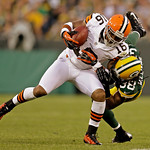Cleveland Browns' Josh Cribbs (16) is tackled by Green Bay Packers' Tramon Williams (38) after a catch during the first half of a preseason NFL football game Thursday, Aug. 16, 2012, in Gree …