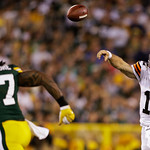 Cleveland Browns quarterback Colt McCoy throws with Green Bay Packers' Jamari Lattimore (57) rushing during the second half of a preseason NFL football game Thursday, Aug. 16, 2012, in Green …